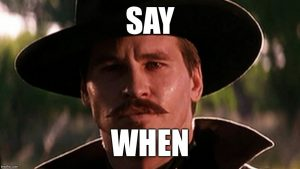 Val Kilmer as Doc Holliday challenges Johnny Ringo in their last duel.